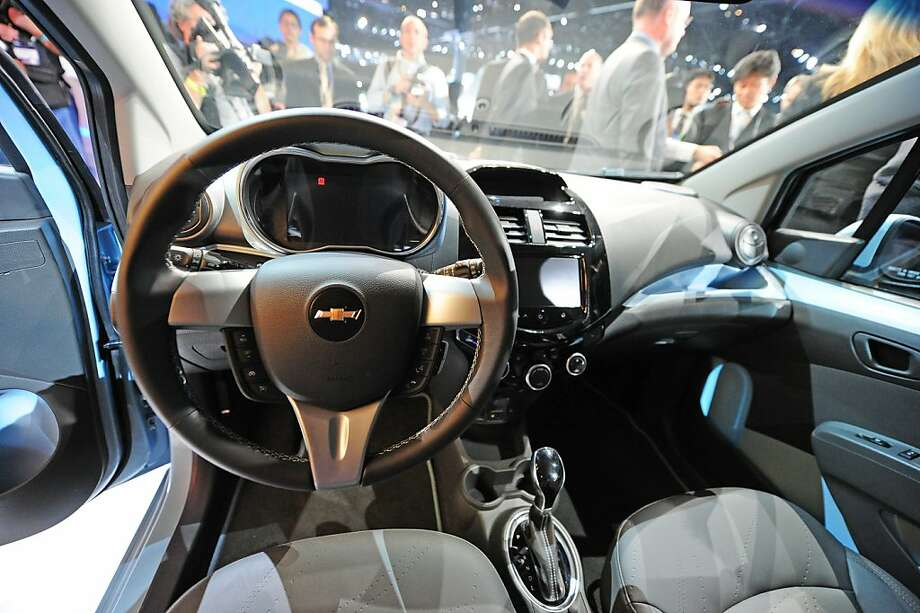 The interior of the 2013 Chevrolet Spark EV is seen as the Spark is unveiled at the Los Angeles Auto Show in Los Angeles, California on media preview day, November 28, 2012. The Spark is Chevrolet's first all electric car. The LA Auto Show will open to the public on November 30 and runs through December 9. Photo: Robyn Beck, AFP/Getty Images