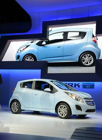 The 2013 Chevrolet Spark EV all electrical car is unveiled at the Los Angeles Auto Show in Los Angeles, California on media preview day, November 28, 2012. The Spark is Chevrolet's first all electric car. The LA Auto Show will open to the public on November 30 and runs through December 9. Photo: Robyn Beck, AFP/Getty Images