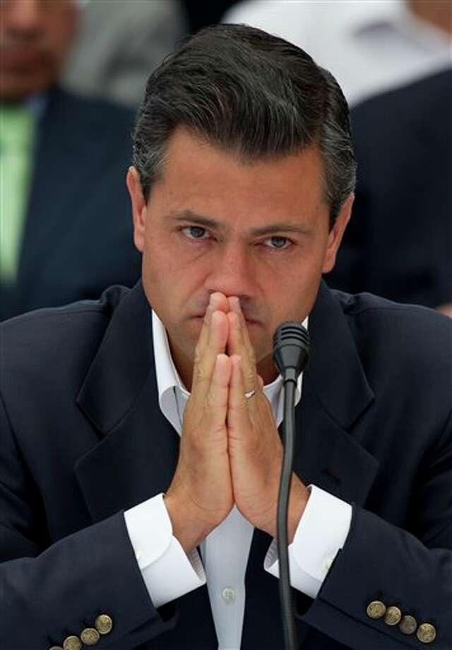 Enrique Pena Nieto, presidential candidate for the Institutional Revolutionary Party, PRI, attends a meeting with Mexican poet Javier Sicilia, leader of the Movement for Peace with Justice and Dignity, and family members of victims of drug gang-related violence at Chapultepec Castle in Mexico City, Monday, May 28, 2012. Pena Nieto was the second of the four presidential candidates to meet with Sicilia and representatives of his movement Monday. Mexico will hold presidential elections on July 1. (AP Photo/Eduardo Verdugo) Photo: Eduardo Verdugo, AP / AP