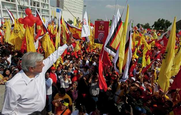 Andres Manuel Lopez Obrador, presidential candidate for the Democratic Revolution Party, PRD, waves to supporters during a campaign rally in Cuautitlan Izcalli, Mexico, Wednesday, June 6, 2012. Mexico will hold presidential elections on July 1. (AP Photo/Eduardo Verdugo) Photo: Eduardo Verdugo, AP / AP