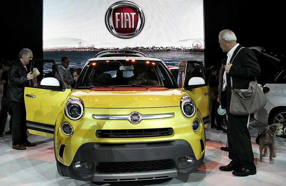 Attendees view the new Fiat 500L vehicle during the LA Auto Show in Los Angeles, California, U.S., on Wednesday, Nov. 28, 2012. After returning to the U.S. with its 500 subcompact in 2010, Fiat plans to introduce an electric version at the Los Angeles Auto Show today. Photo: Jonathan Alcorn, Bloomberg