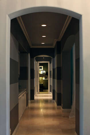 A hallway in the home of Reema and Naveen Kella in San Antonio on Wednesday, Nov. 28, 2012. Photo: Lisa Krantz, San Antonio Express-News / © 2012 San Antonio Express-News