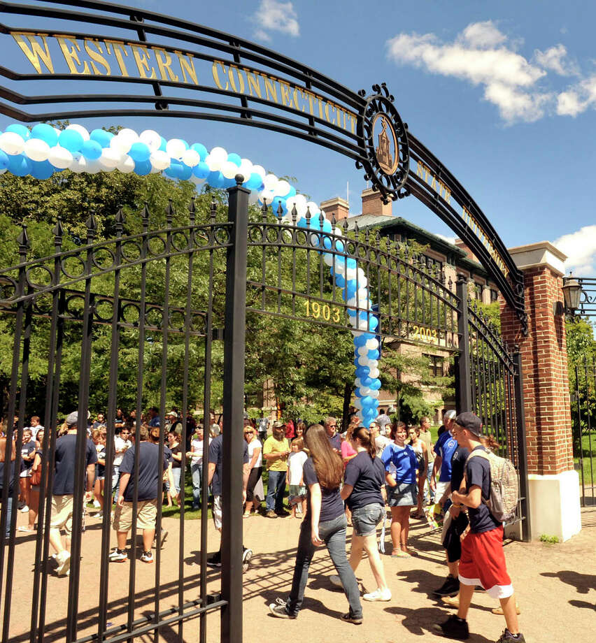 WestConn freshmen enter The Gates, a ceremony welcoming freshmen and signaling the start of the academic year. The event took place at the Midtown campus, Friday, Aug 27, 2010. Photo: Michael Duffy, ST / The News-Times
