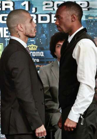 Puerto Rico's Miguel Cotto, left,  and undefeated WBA Super Welterweight World Champion Austin Trout,  from Las Cruces, New Mexico, pose after a press conference on Wednesday, Nov. 28, 2012 in New York.  The super welterweights headline the card of World championship boxing at Madison Square Garden on Saturday, Dec. 1.  (AP Photo/Bebeto Matthews) Photo: Bebeto Matthews, Associated Press / AP