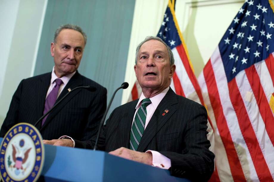 New York City Mayor Michael Bloomberg, right, accompanied by Sen. Charles Schumer, D-N.Y. speaks during a news conference on Capitol Hill in Washington, Wednesday, Nov. 28, 2012, to discuss disaster relief funds for Superstorm Sandy.  (AP Photo/ Evan Vucci) Photo: Evan Vucci, STF / AP