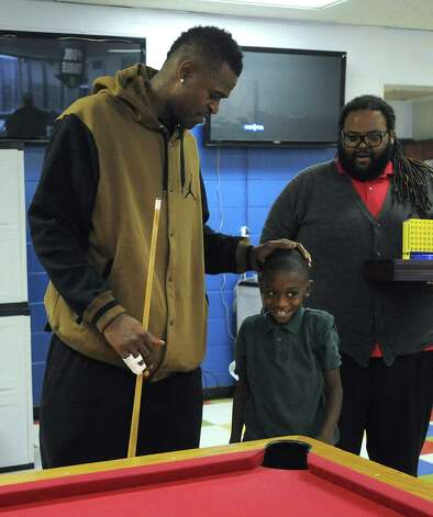 "Travon Davis, 8, meets Stephen Jackson of the San Antonio Spurs during a visit to the Eastside Boys & Girls Club by Jackson and teammate Kawhi Leonard on Wednesday, Nov. 28, 2012. ""I want to ask him if he can dunk,"" Travon said. Photo: Billy Calzada, San Antonio Express-News / SAN ANTONIO EXPRESS-NEWS"