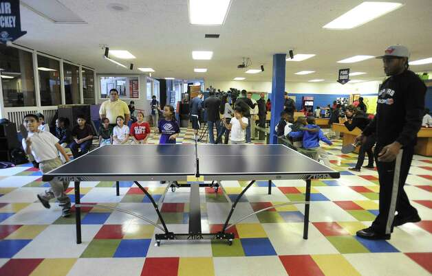 Kawhi Leonard of the San Antonio Spurs, right, plays table tennis with Wagner Munoz, 8, at the Eastside Branch of the Boys & Girls Club on Wednesday, Nov. 28. Leonard and teammate Stephen Jackson visited the club. Photo: Billy Calzada, San Antonio Express-News / SAN ANTONIO EXPRESS-NEWS