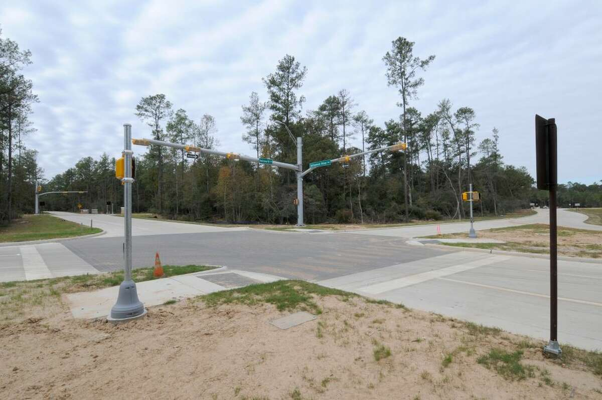 The planned intersection of two major thoroughfares through Springwoods Village: Holzwarth Road and Springwoods Village Parkway.