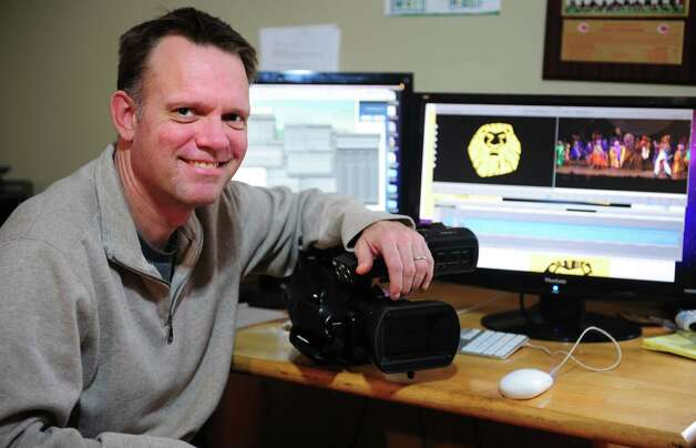 David Kane edits a video in his Westport home studio.  His one-man video production business, David Kane Productions, shoots and edits Broadway shows. Photo: Autumn Driscoll / Connecticut Post