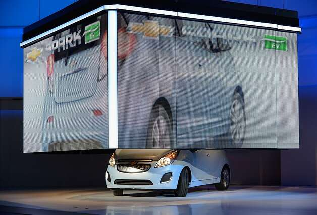 he new 2014 Chevy Spark EV electric vehicle is unveiled during the Los Angeles Auto show on November 28, 2012 in Los Angeles, California. The LA Auto Show opens to the public on November 30 and runs through December 9. Photo: Kevork Djansezian, Getty Images