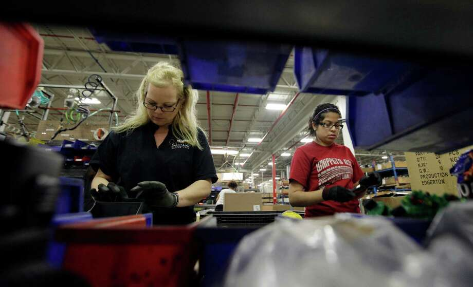 Itzel Nino works on the assembly line at Generac Power Systems, one of the largest makers of residential generators in the U.S., in Whitewater, Wis. U.S. manufacturing shrank in November, the Institute for Supply Management says. Photo: Nam Y. Huh, STF / AP
