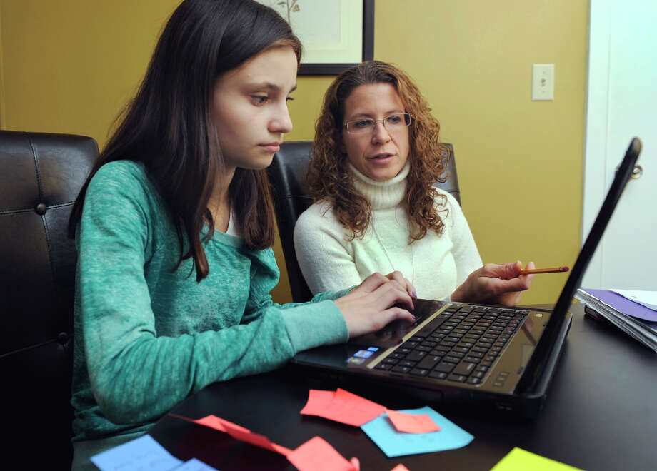 Carly Goldstein, 12, a seventh-grader from South Salem, N.Y., works on writing skills with Michelle Brinck, of Wilton, executive director of Wise Learning, on Wednesday, Nov. 28, 2012. Photo: Carol Kaliff / The News-Times