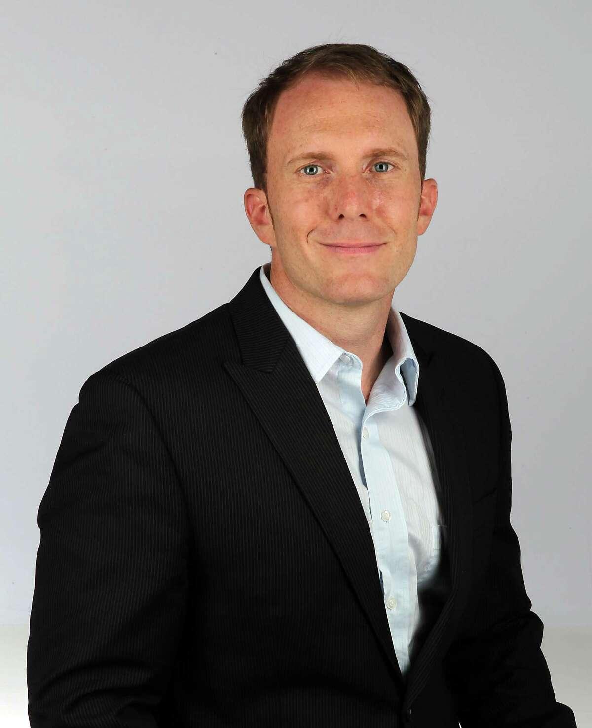 Houston Chronicle editorial employee Brian Smith Tuesday, Oct. 23, 2012, in Houston. ( James Nielsen / Chronicle )
