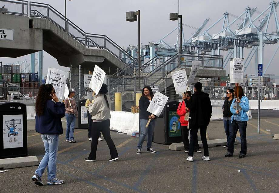 Protesters walk the picket line during day two of a union walkout at the Port of Los Angeles. Photo: Nick Ut, Associated Press