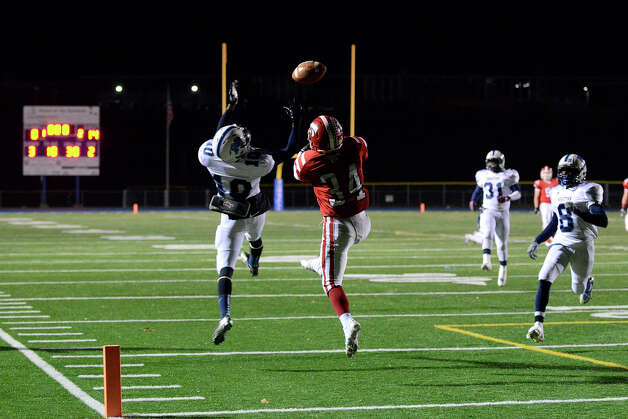 The long pass eludes Masuk's Frank Bacarella and Middletown's DeJavon Green as Masuk High School challenges Middletown High School in the Class L state varsity football quarterfinal game at Bunnell High School in Stratford, CT on Nov. 28, 2012. Photo: Shelley Cryan / Shelley Cryan for the CT Post/ freelance Shelley Cryan