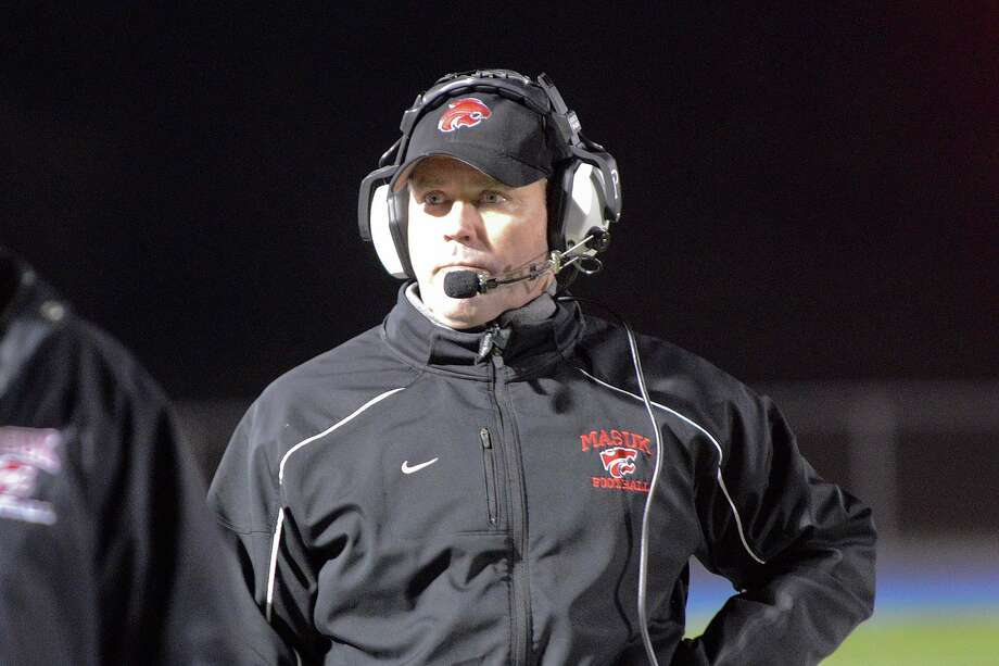 Masuk head coach John Murphy walks the sidelines as Masuk High School challenges Middletown High School in the Class L state varsity football quarterfinal game at Bunnell High School in Stratford, CT on Nov. 28, 2012. Photo: Shelley Cryan / Shelley Cryan for the CT Post/ freelance Shelley Cryan