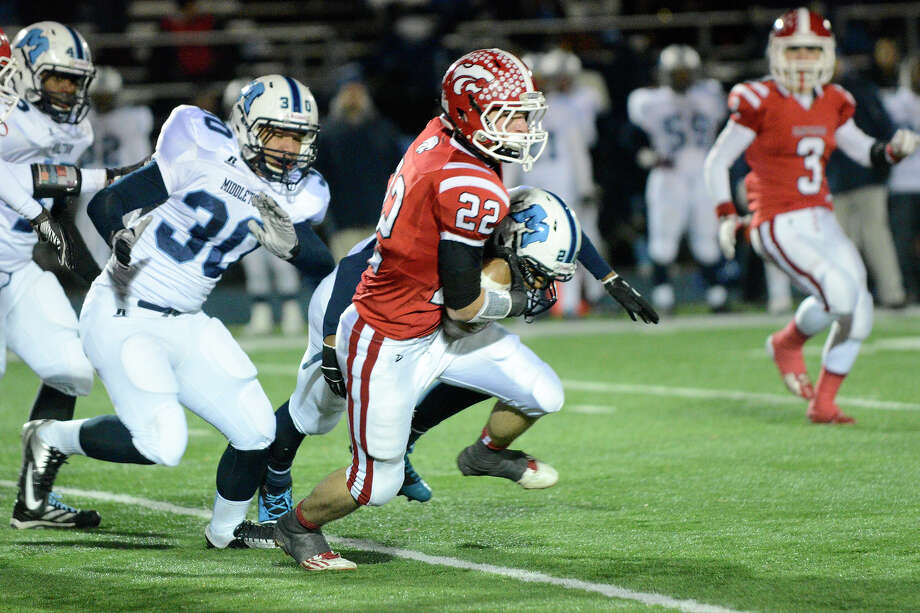 Masuk's Thomas Milone gains some yardage as Masuk High School challenges Middletown High School in the Class L state varsity football quarterfinal game at Bunnell High School in Stratford, CT on Nov. 28, 2012. Photo: Shelley Cryan / Shelley Cryan for the CT Post/ freelance Shelley Cryan
