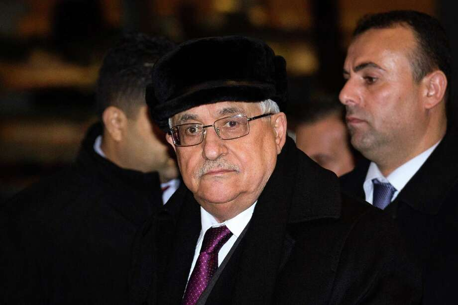 Palestinian President Mahmoud Abbas arrives at the United Nations Plaza Hotel, Tuesday, Nov. 27, 2012, in New York. The Palestinians predicted a historic U.N. vote recognizing their statehood this week, praising important new support from France on Tuesday and likely backing from other European nations seen as critical to enhancing their international standing. (AP Photo/John Minchillo) Photo: John Minchillo