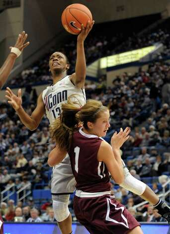 Connecticut's Brianna Banks, top is fouled as she goes up for a basket by Colgate's Lauryn Kobiela (1) during the first half of a NCAA college basketball game in Hartford, Conn., Wednesday, Nov. 28, 2012. (AP Photo/Jessica Hill) Photo: Jessica Hill, Associated Press / FR125654 AP