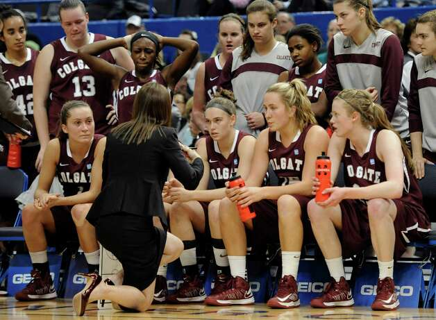 Colgate head coach Nicci Hays Fort speaks to her team during a timeout in the first half of a NCAA college basketball game in Hartford, Conn., Wednesday, Nov. 28, 2012. (AP Photo/Jessica Hill) Photo: Jessica Hill, Associated Press / FR125654 AP