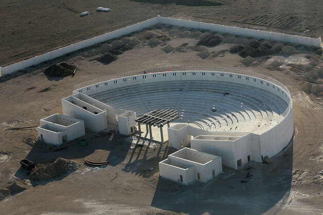 Aerial view of an unfinished amphitheater at the Yearning for Zion ranch in Eldorado, Texas on Wednesday, Nov. 28, 2012. The Texas attorney general's office filed documents to seize the ranch on Wednesday. The property belonged to Warren Jeffs who served as the spiritual leader and prophet of the Fundamentalist Church of Latter Day Saints. Jeffs was convicted on two child sex charges and sentenced to life plus 20 years in prison. Photo: Kin Man Hui, San Antonio Express-News / © 2012 San Antonio Express-News