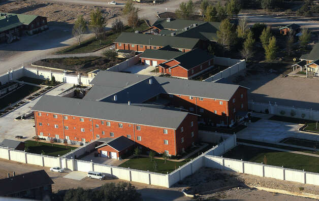 Aerial view of lodging at the Yearning for Zion ranch in Eldorado, Texas on Wednesday, Nov. 28, 2012. The Texas attorney general's office filed documents to seize the ranch on Wednesday. The property belonged to Warren Jeffs who served as the spiritual leader and prophet of the Fundamentalist Church of Latter Day Saints. Jeffs was convicted on two child sex charges and sentenced to life plus 20 years in prison. Photo: Kin Man Hui, San Antonio Express-News / © 2012 San Antonio Express-News