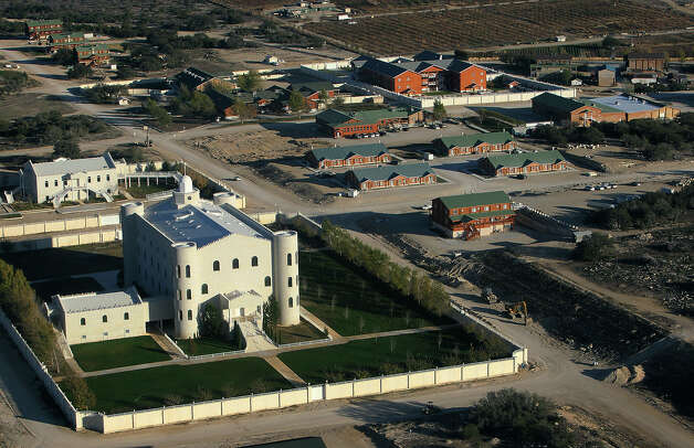 Aerial view of the church and surrounding lodging at the Yearning for Zion ranch in Eldorado, Texas on Wednesday, Nov. 28, 2012. The Texas attorney general's office filed documents to seize the ranch on Wednesday. The property belonged to Warren Jeffs who served as the spiritual leader and prophet of the Fundamentalist Church of Latter Day Saints. Jeffs was convicted on two child sex charges and sentenced to life plus 20 years in prison. Photo: Kin Man Hui, San Antonio Express-News / © 2012 San Antonio Express-News
