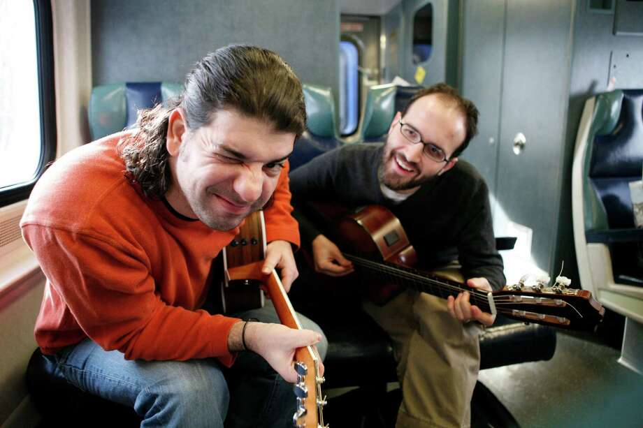 "Isra-Alien releases it new CD, ""Somewhere is Here!"" Saturday, Dec. 8 in Middletown. At left is Oren Neiman, on nylon string guitar, and his partner, Gilad Ben-Zvi, on steel strings. Photo: Contributed Photo"