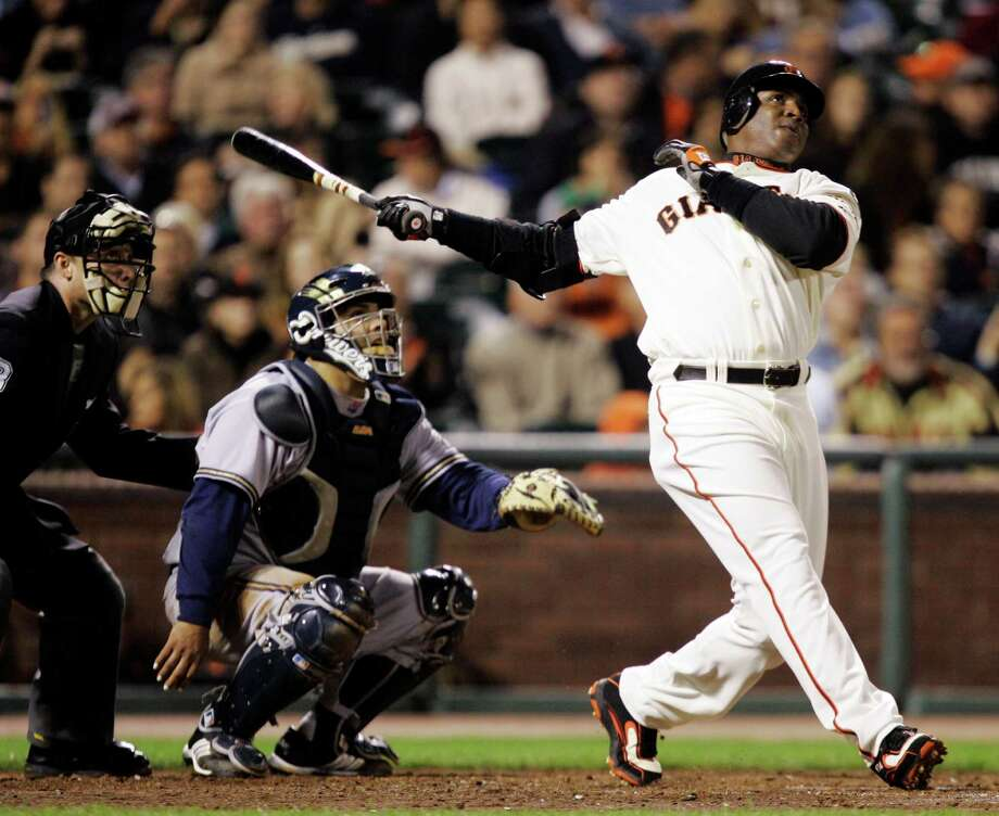 FILE - In this Aug. 24, 2007, file photo, San Francisco Giants' Barry Bonds, right, hits his 761st career home run, a solo effort, off Milwaukee Brewers pitcher Chris Capuano in the fourth inning of a baseball game in San Francisco. Bonds, Roger Clemens and Sammy Sosa are set to show up on the Hall of Fame ballot for the first time on Wednesday, Nov. 28, 2012, and fans will soon find out whether drug allegations block the former stars from reaching baseball's shrine. (AP Photo/Marcio Jose Sanchez, File) Photo: Marcio Jose Sanchez