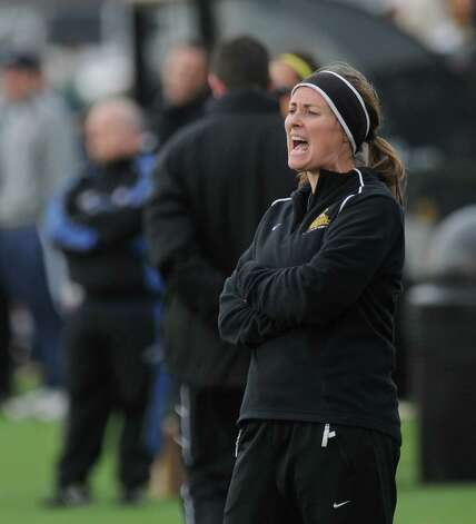 College of Saint Rose women's soccer team head coach Laurie Darling Gutheil yells instruction to her team near the end of St. Rose's 5-0 victory over Merrimack in a second round NCAA tournament game on Sunday Nov. 13, 2011 in Albany, NY.  (Philip Kamrass / Times Union ) Photo: Philip Kamrass / 00015384A