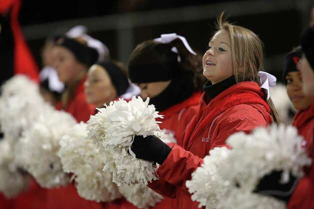 Mike Ross Connecticut Post freelance -Greenwich High School cheerleaders work the sidelines during Wednesday evening Class LL football quarterfinals against Xavier High School. Photo: Mike Ross / Connecticut Post Freelance