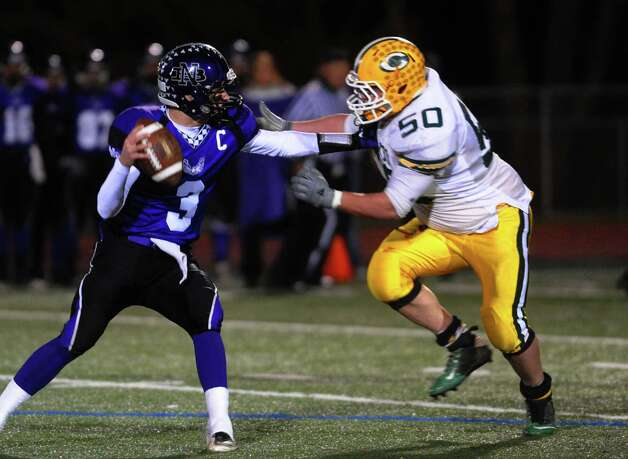 Trinity Catholic's #50 Riley Kinahan bears down on North Branford QB Brandan Basil, during CIAC Class S boys football quarterfinal action in Guilford, Conn. on Wednesday November 28, 2012. Photo: Christian Abraham / Connecticut Post