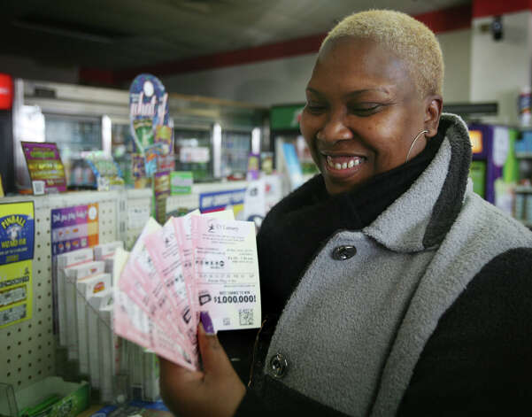 Rhonda Bennett of Bridgeport smiles as she looks at her Powerball numbers that she purchased at News Express at 200 Tunxis Hill Road in Fairfield on Wednesday, November, 28, 2012. Photo: Brian A. Pounds / Connecticut Post