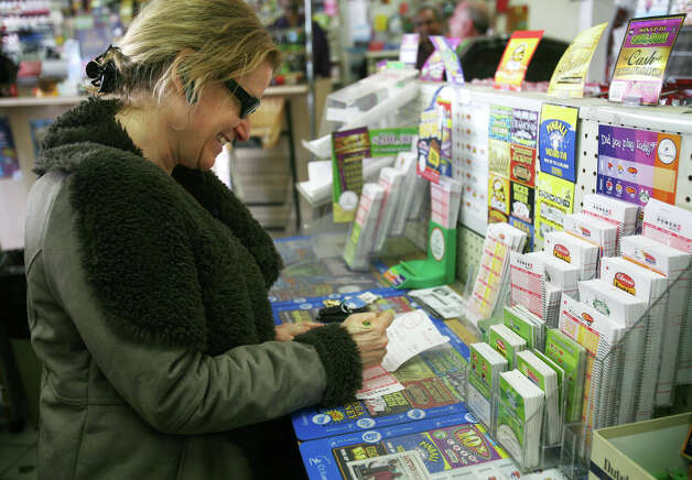 Lisa Stein of Fairfield fills out her Powerball numbers at News Express at 200 Tunxis Hill Road in Fairfield on Wednesday, November, 28, 2012. Photo: Brian A. Pounds / Connecticut Post