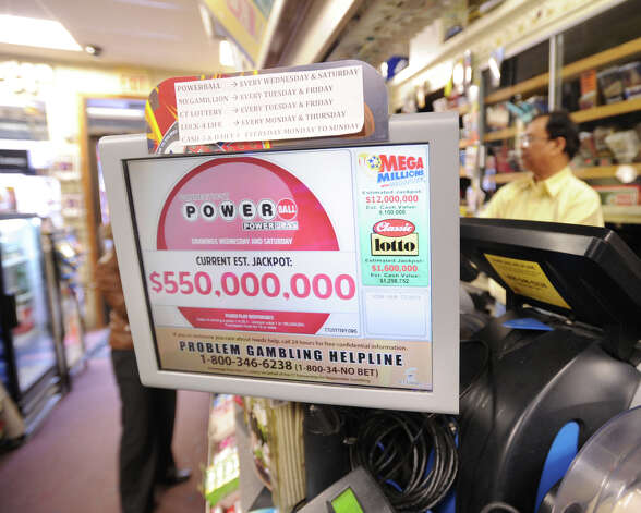 The estimated Powerball lottery jackpot sign reads $550 million inside the Greenwich Cigar Store on Railroad Avenue, Wednesday afternoon, Nov. 28, 2012. Photo: Bob Luckey / Greenwich Time