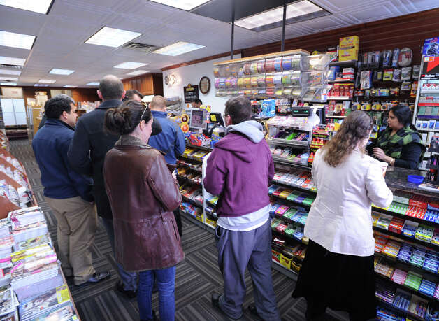 The line for Powerball lottery tickets inside Zyn's News & Cigar store on Greenwich Avenue, Wednesday afternoon, Nov. 28, 2012. The jackpot for the lottery exceeded $550 million. Photo: Bob Luckey / Greenwich Time