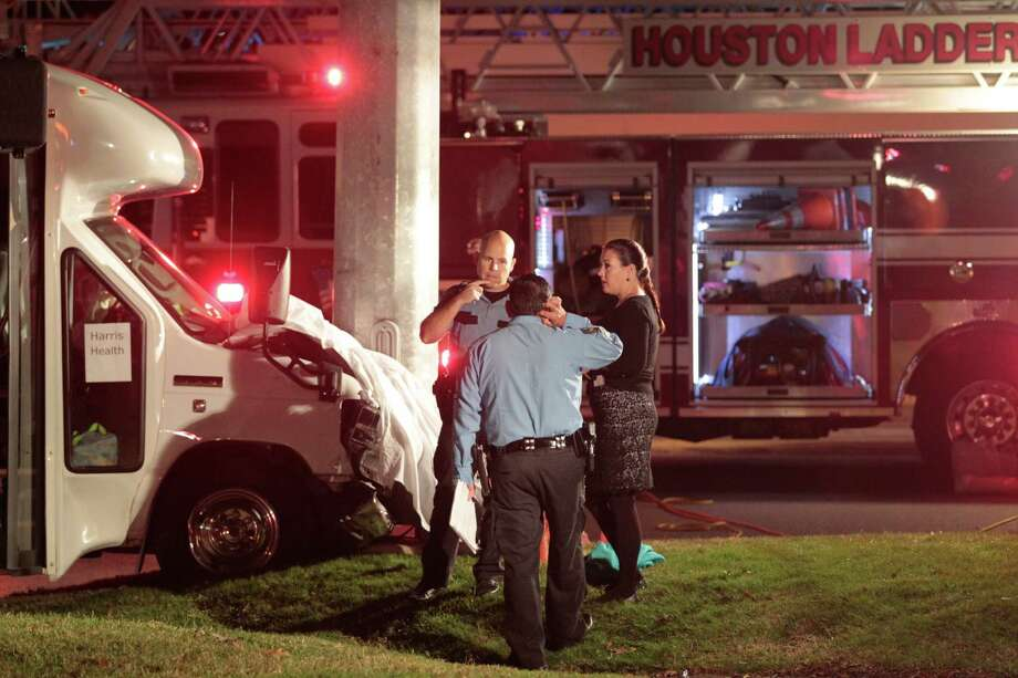 Houston police investigate the crash at Holcombe and South Braeswood on Wednesday. Photo: Billy Smith II, Chronicle