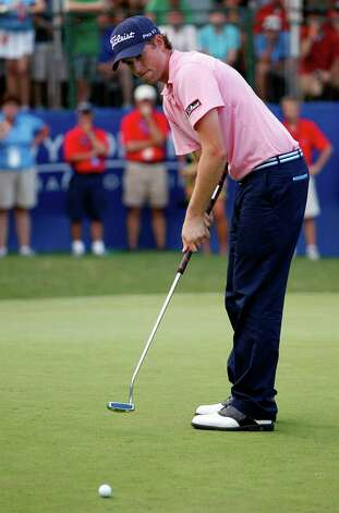 FILE - In this Aug. 20, 2011, file photo,Webb Simpson putts on the 18th hole during the third round of the Wyndham Championship golf tournament in Greensboro, N.C. Webb Simpson and Keegan Bradley, two of the major faces in the debate over belly putters, said Tuesday, Nov. 27, 2012, they would not fight a change in the rules if golf's governing bodies decide to outlaw putters anchored to the body. (AP Photo/Chuck Burton, File) Photo: Chuck Burton