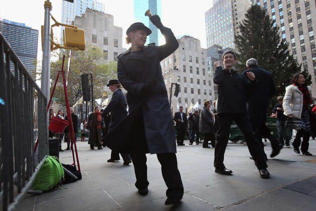 NEW YORK, NY - NOVEMBER 28:  Salvation Army volunteers dance for donations as preparations are made for the lighting of the Christmas tree at Rockefeller Center on November 28, 2012 in New York City. After two weeks of preparation, the 45,000 lights will be lit on the 80-foot high Norwegian spruce this evening during a celebration televised on NBC. The tree will remain lit every evening until January 7.  (Photo by John Moore/Getty Images) Photo: John Moore, Getty Images / Getty Images