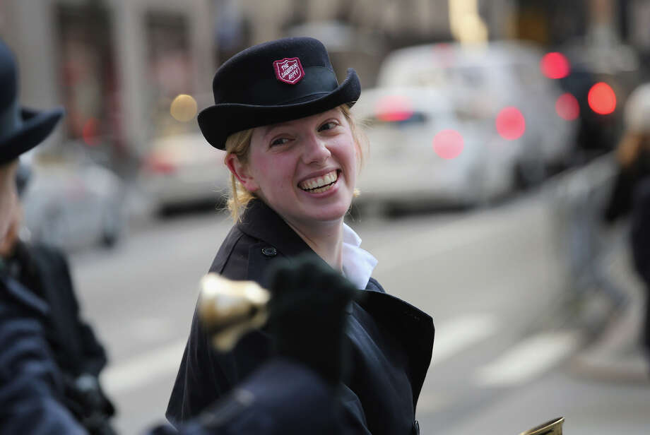 NEW YORK, NY - NOVEMBER 28:  Salvation Army volunteer Jessie Rock dances for donations as preparations are made for the lighting of the Christmas tree at Rockefeller Center on November 28, 2012 in New York City. After two weeks of preparation, the 45,000 lights will be lit on the 80-foot high Norwegian spruce this evening during a celebration televised on NBC. The tree will remain lit every evening until January 7.  (Photo by John Moore/Getty Images) Photo: John Moore, Getty Images / Getty Images