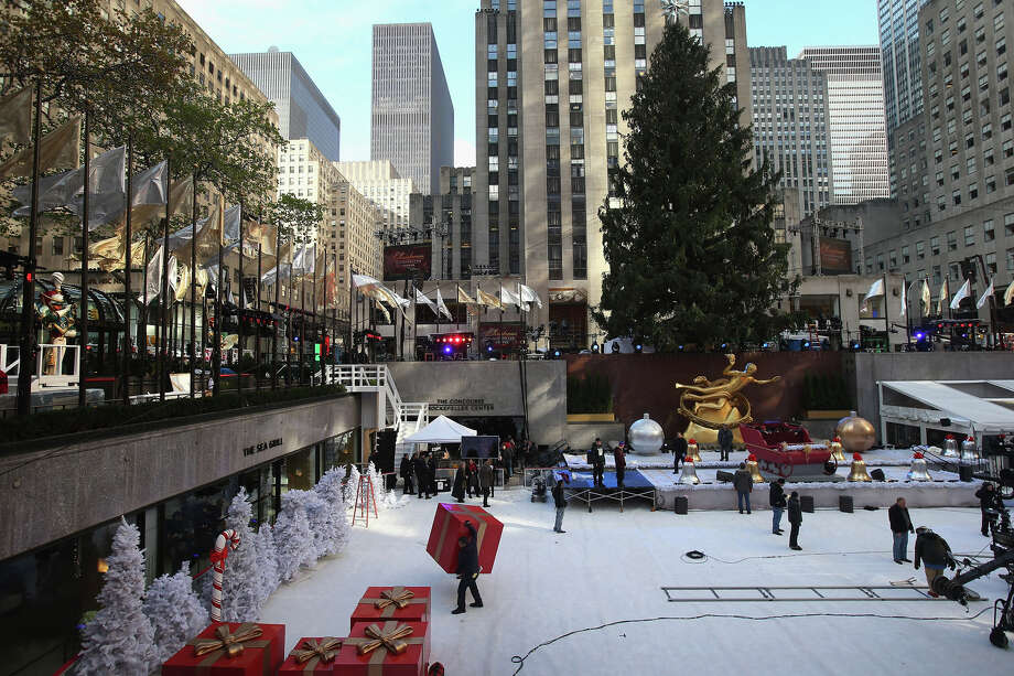 NEW YORK, NY - NOVEMBER 28:  Preparations are made ahead of the lighting of the Christmas tree at Rockefeller Center on November 28, 2012 in New York City. After two weeks of preparation, the 45,000 lights will be lit on the 80-foot high Norwegian spruce this evening during a celebration televised on NBC and hosted by Al Roker and Savannah Guthrie. The tree will remain lit every evening until January 7. (Photo by John Moore/Getty Images) Photo: John Moore, Getty Images / Getty Images