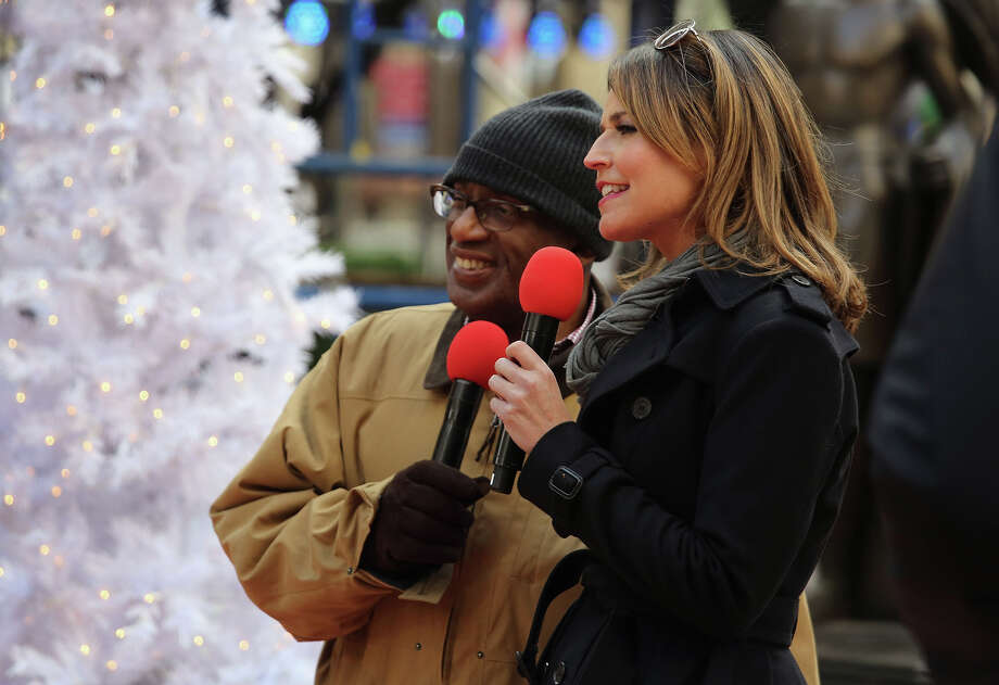 NEW YORK, NY - NOVEMBER 28:  NBC hosts Al Roker (L) and Savannah Guthrie rehearse as preparations are made for the lighting of the Christmas tree at Rockefeller Center on November 28, 2012 in New York City. After two weeks of preparation, the 45,000 lights will be lit on the 80-foot high Norwegian spruce this evening during a celebration televised on NBC. The tree will remain lit every evening until January 7.  (Photo by John Moore/Getty Images) Photo: John Moore, Getty Images / Getty Images