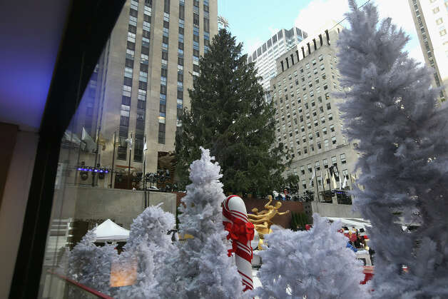 NEW YORK, NY - NOVEMBER 28:  Props are put into place ahead of the lighting of the Christmas tree at Rockefeller Center on November 28, 2012 in New York City. After two weeks of preparation, the 45,000 lights will be lit on the 80-foot high Norwegian spruce this evening during a celebration televised on NBC and hosted by Al Roker and Savannah Guthrie. The tree will remain lit every evening until January 7.  (Photo by John Moore/Getty Images) Photo: John Moore, Getty Images / Getty Images