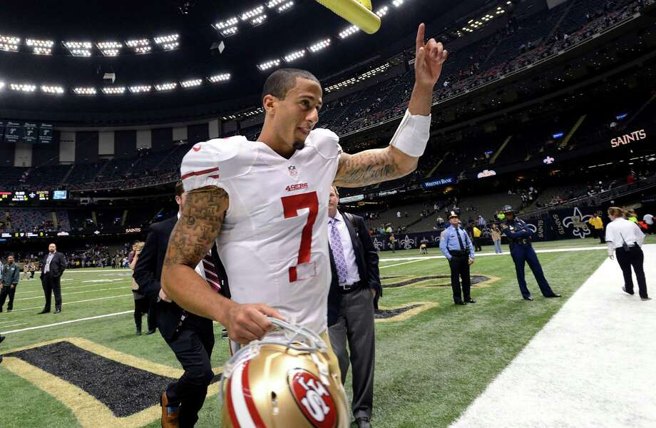 San Francisco 49ers quarterback Colin Kaepernick (7)  gestures after his second start in an NFL football game against the New Orleans Saints in New Orleans, Sunday, Nov. 25, 2012. The 49ers defeated the Saints 31-21. (AP Photo/Bill Feig) Photo: Bill Feig