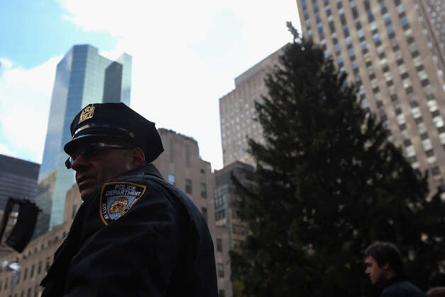 NEW YORK, NY - NOVEMBER 28:  New York police stand by for crowd control as preparations are made forthe lighting of the Christmas tree at Rockefeller Center on November 28, 2012 in New York City. After two weeks of preparation, the 45,000 lights will be lit on the 80-foot high Norwegian spruce this evening during a celebration televised on NBC and hosted by Al Roker and Savannah Guthrie. The tree will remain lit every evening until January 7.  (Photo by John Moore/Getty Images) Photo: John Moore, Getty Images / Getty Images