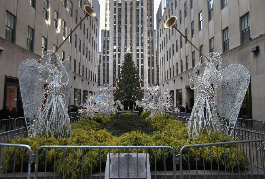 NEW YORK, NY - NOVEMBER 28:  The Christmas tree at Rockefeller Center awaits lighting on November 28, 2012 in New York City. After two weeks of preparation, the 45,000 lights will be lit on the 80-foot high Norwegian spruce this evening during a celebration televised on NBC and hosted by Al Roker and Savannah Guthrie. The tree will remain lit every evening until January 7.  (Photo by John Moore/Getty Images) Photo: John Moore, Getty Images / Getty Images