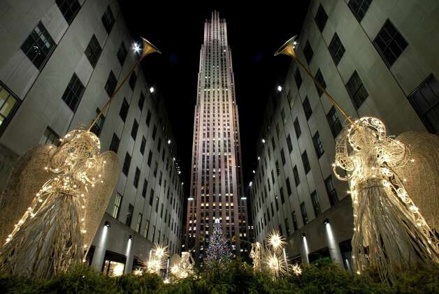 Angels in lights frame the Rockefeller Center Christmas tree is shown after it was lit up during the 80th annual tree lighting ceremony at Rockefeller Center in New York, Wednesday, Nov. 28, 2012.  (AP Photo/Kathy Willens) Photo: Kathy Willens, Associated Press / Associated Press