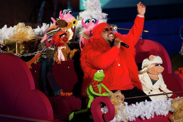 CeeLo Green performs with the Muppets at the 80th annual Rockefeller Center Christmas tree lighting ceremony on Wednesday, Nov. 28, 2012 in New York. (Photo by Charles Sykes/Invision/AP) Photo: Charles Sykes, Associated Press / Associated Press