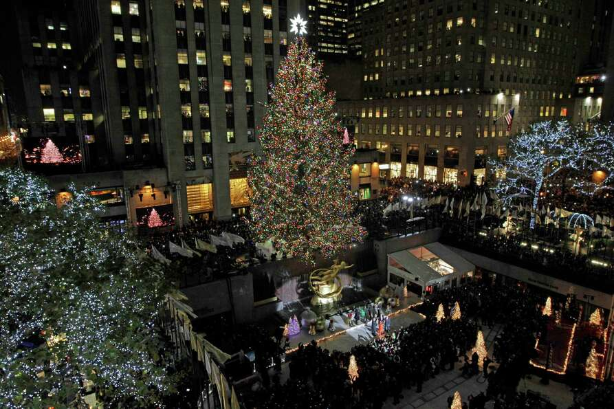 The Rockefeller Center Christmas Tree is lit during the 80th annual tree lighting ceremony at Rockef