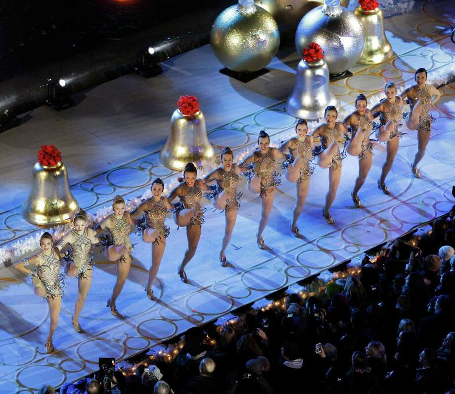The Radio City Music Hall Rockettes perform before the Rockefeller Center Christmas Tree is lit during the 80th annual tree lighting ceremony at Rockefeller Center in New York, Wednesday, Nov. 28, 2012.  (AP Photo/Kathy Willens) Photo: Kathy Willens, Associated Press / Associated Press